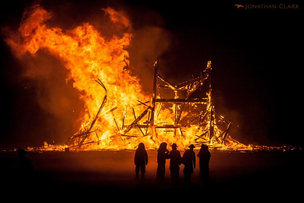 firemen-crew-at-the-base-of-the-burning-man-explosion-burning-man-2013-cargo-cult-black-rock-city-playa-jonathan-clark