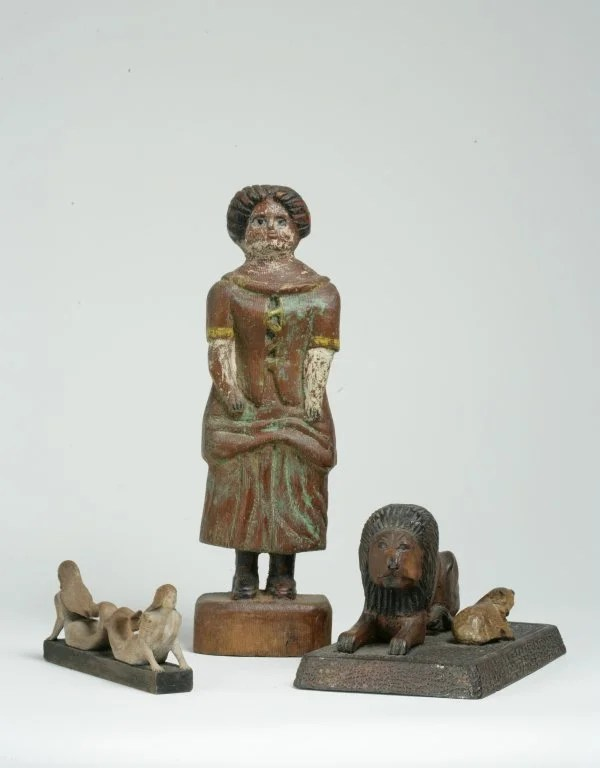 6: A Group of Four Carved and Painted Wooden Figures