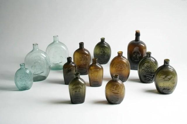 33: Group of Thirteen Flasks