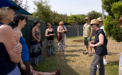 Standing in the shade, Fiona and Steve (right) talk with the group about the development of the permaculture interpretive garden.