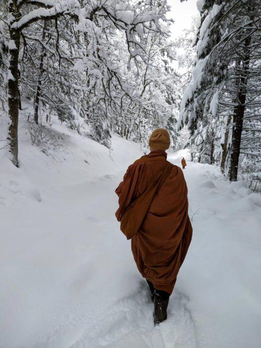 Photo of monks walking alms through the snow in White Salmon