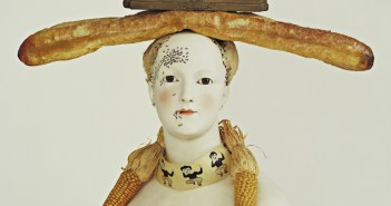Retrospective Bust of a Woman 1933 (some elements reconstructed 1970) Painted porcelain, bread, corn, feathers, paint on paper, beads, ink stand, sand, and two pens 29 x 27 1/4 x 12 5/8 inches by Salvador Dalí  (1904-1989)