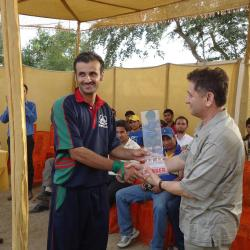 Captain Shiskat Team getting trophy from Eng. Ghulam Karim