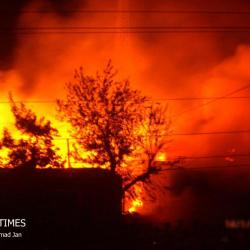 Flames could be seen from miles away as the timber market burnt to ashes. Photos: Khurshid Ahmad Jan