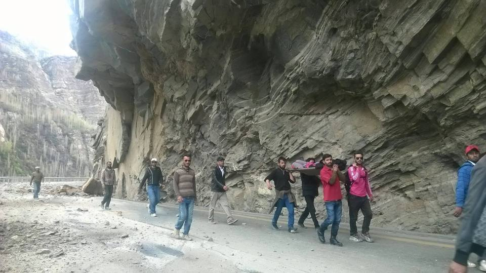 On 5th of April a group of young volunteers from Hussani village of Gojal can be seen carrying a female patient to Aliabad, Hunza. Photo: Akram Shah