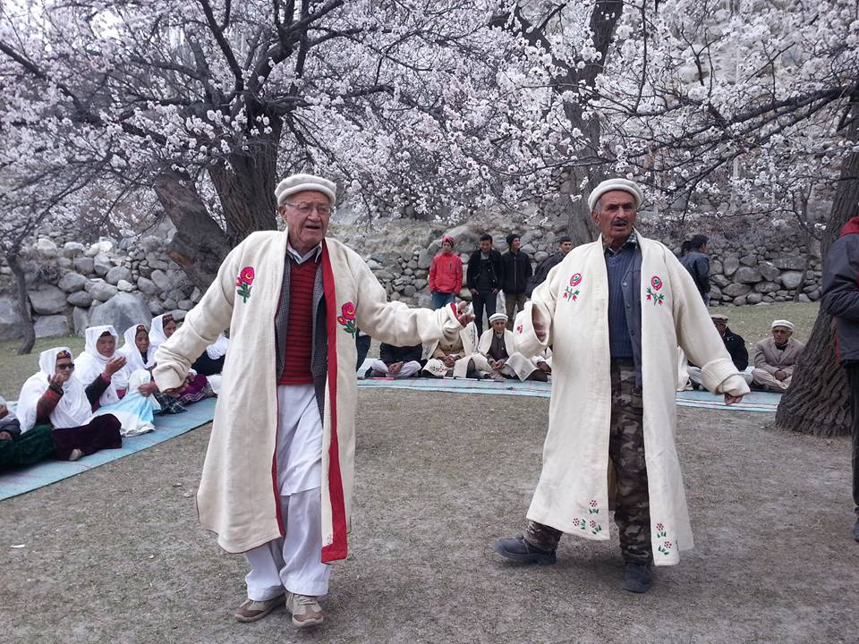 Traditional dance in long woolen robs