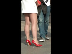 Cute girl in sexy red pumps.