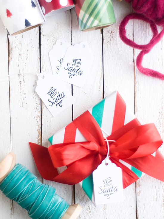 "Free Printable ""From Santa"" Holiday Gift Tags by Confetti Sunshine for DIY Candy"
