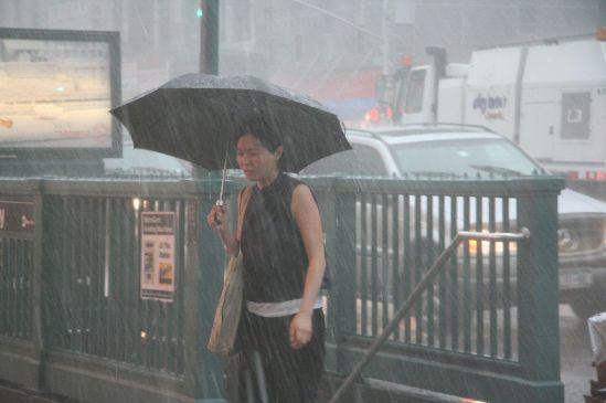 Woman with umbrella, Chinatown, New York (Photo: Morten Skogly)