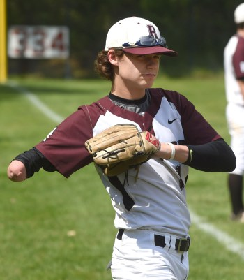 Radnor's Andrew Austin warms up before a game last week. (PETE BANNAN -- DIGITAL FIRST MEDIA)