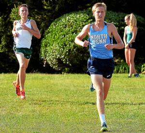 Bob Raines--Digital First Media North Penn's Brendan O'Toole leads Pennridge's Matt Eissor during the cross country meet at North Penn High School Sept. 21, 2016.