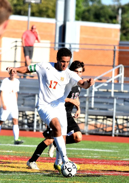 Haverford High's Ibrahim Anmar dribbles past Garnet Valley's Andrew Weir. The Jaguars won the Central League match, 2-1. (Digital First Media/Anne Neborak)