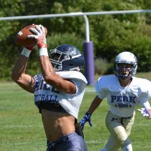 A Hill School receiver hauls in a reception during the team's joint practice with the Perkiomen School last week. (Sam Stewart - Digital First Media)