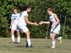 Norristown's Ashley Schools, right, is congratulated by Anayeli Tellez after her goal in the first half, which was assisted by sister Emily Schools, background. (Austin Hertzog - Digital First Media)