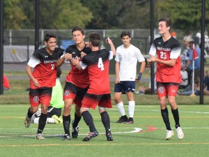 Germantown Academy's Zander Foglia, facing, is congratulated by Michael Capone (7), Oliver Buck (4) and James Thatcher (23), who had the assist, after scoring in the second half against Hill School Wednesday. (Austin Hertzog - Digital First Media)