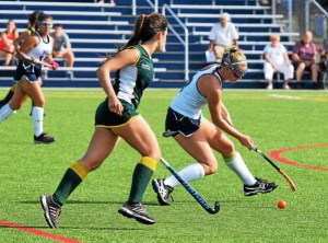 The Hill School's Maddie Mitchell (8) looks to cut back with the ball as a British School of Uruguay player defends during Wednesday's game. (Austin Hertzog - Digital First Media)