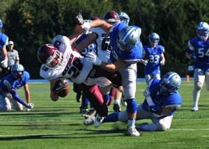 Great Valley's Ryan Hubley makes a hit on Brandon Holz to prevent a Hornet TD.