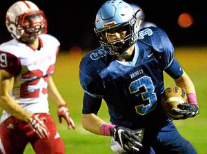 Bob Raines--Digital First Media North Penn's Owen Thomas scores after pulling in a short pass during the home game against Souderton Oct. 14, 2016.