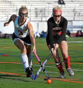 PETE BANNAN-DIGITAL FIRST MEDIA Unionville's #3 Brooke Ladd and Upper Dublin #34 Alex Thompson battle for ball control Wednesday during PIAA playoffs at Unionville. To the right is Upper Dublin defender Allie DeMichele.