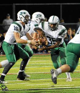 Pennridge QB Jagger Hartshorn handed the ball to RB Josh Pinckney during Friday night's game against CB South on Friday night.