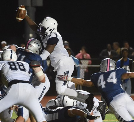 Episcopal Academy's Jon'avin Freeman leaps over the pile for a score that put EA up 34-9. They hung on to win, 37-34. (Digital First Media/Pete Bannan)