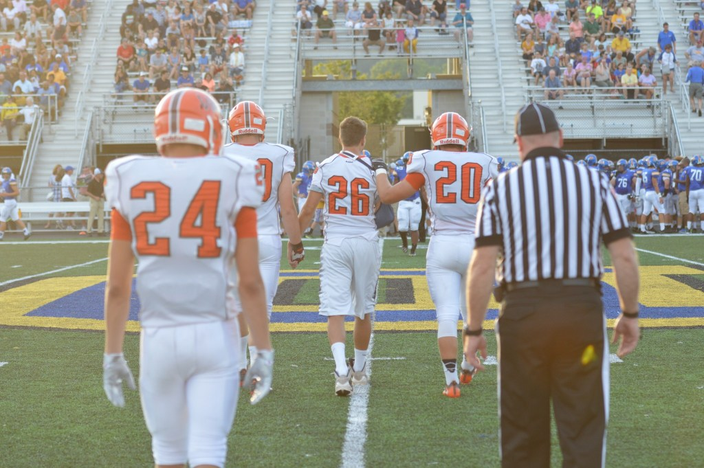 Perkiomen Valley's Ryan McCourt, center, walks out to the field with Nick Marren, right, and Vaughn Stolzer, left, prior to the team's first game against Downingtown West. McCourt misses the first eight games due to a broken arm but is back in time for the PAC title game. (Sam Stewart - Digital First Media)