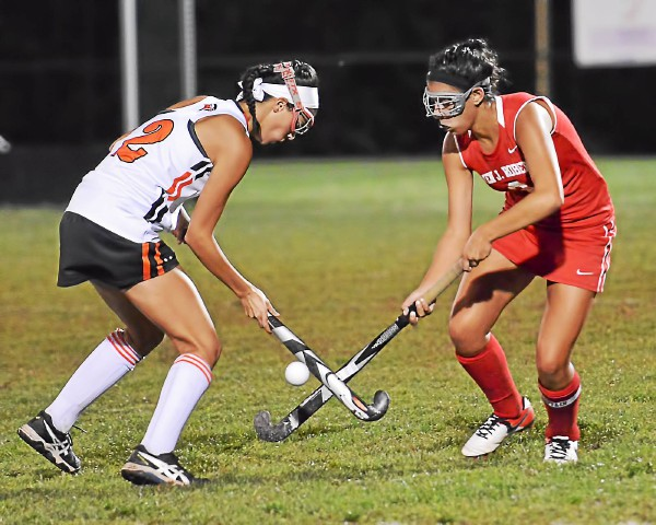 Owen J. Roberts' Sarah Garritano tries to get the ball away from the stick of Perkiomen Valley's Morgan Narducci during the first half. (Sam Stewart - Digital First Media)