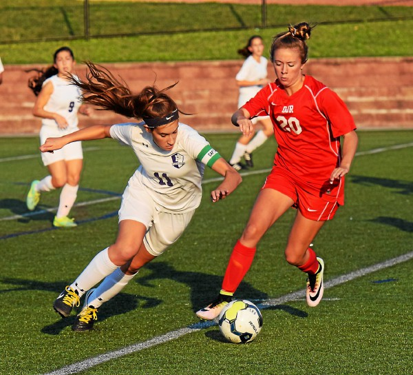 Phoenixville's Dakota Graham (11) tries to get by Owen J. Roberts' Caroline Thompson during their PAC semifinal Tuesday. (Austin Hertzog - Digital First Media)