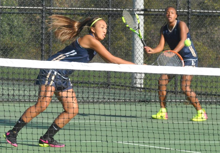 Spring-Ford's Kathryn Alvarez, front, returns a shot during the PAC Doubles Championships Saturday at Perkiomen Valley. (Barry Taglieber - For DFM)