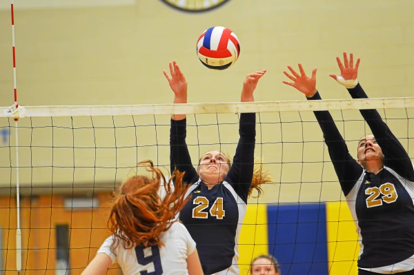 Spring-Ford's Ally Angelucci (24) tries to get the ball back over the net after the spike attempt from PJP's Mary Kate Mooney. (Sam Stewart - Digital First Media)