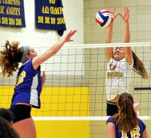 Bob Raines--Digital First Media Lizzy Ferguson (Gwynedd Mercy) blocks a spike by Cassidy Abdalla (Mount Saint Joseph's) Nov. 1, 2016.