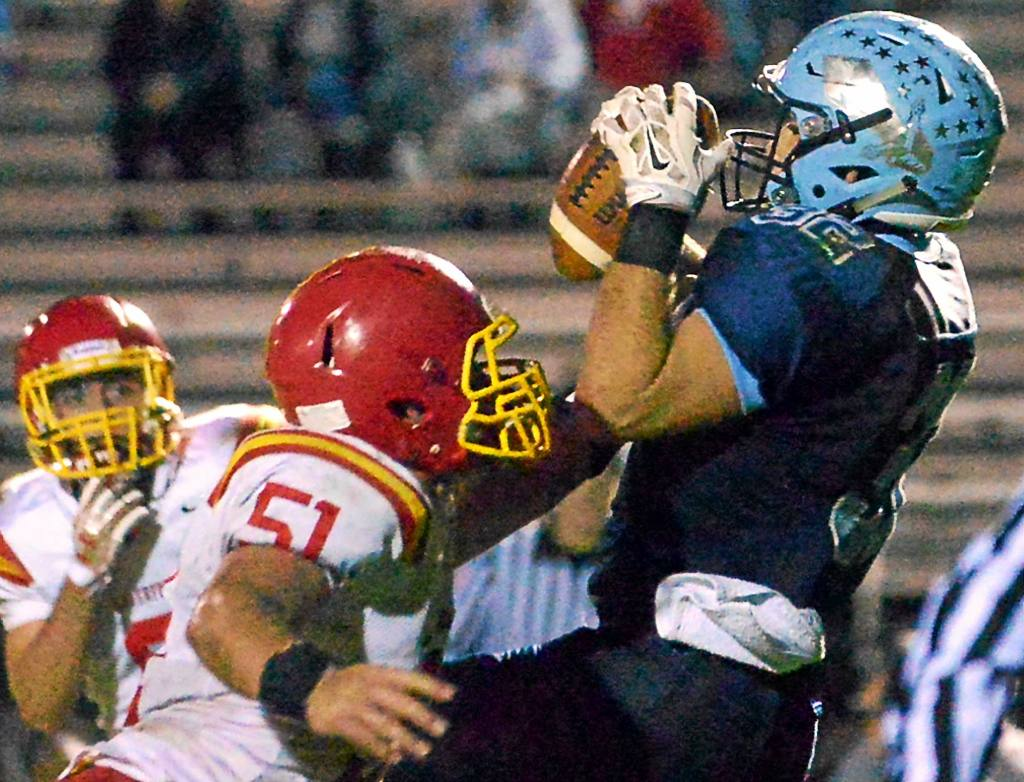 Bob Raines--Digital First Media Nick Vasger (North Penn) pulls in Reece Udinski's pass in the endzone during the Nov. 4, 2016 home game against Haverford.