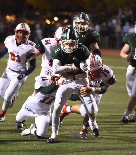 Ridley quarterback Cade Stratton runs for the goal line in the first half against Plymouth Whitemarsh. The Green Raiders won 35-7 to advance to the next round to meet Coatesville in the district playoffs. (Digital First Media/Pete Bannan)