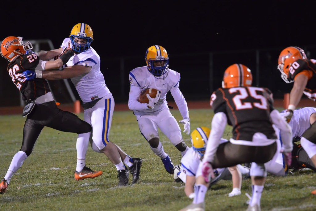 Downingtown East's Jeremy Jennings looks for space to run through during the first quarter. (Sam Stewart - Digital First Media)