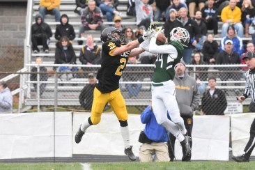 Ridley's Allen Martin, right, disrupts a pass intended for Interboro's Connor Adams Thursday morning. Martin and the Green Raiders claimed a 29-22 win over the host Bucs in the 48th Thanksgiving Day meeting between the crosstown rivals. (ANNE NEBORAK - DIGITAL FIRST MEDIA)