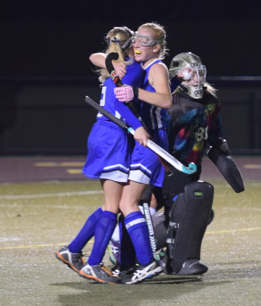 Oley Valley's Sam Buzalewski, right, and Hannah Beers hug after Beers tipped in Buzalewski's shot for a goal in the second half against Lake Lehman in a PIAA Class A field hockey semifinal at Whitehall on Nov. 15. (Austin Hertzog - Digital First Media)