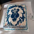 14. Homemade Alliance lion banner cake