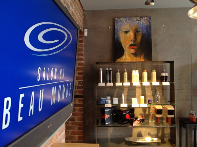 The interior at Salon Du Beau Monde, where Dallas carries art through the guest experience. | Source: Dallas Alleman