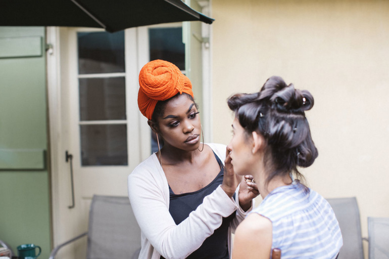 Claire Simmons, Makeup Artist & Skin Care Specialist at Paris Parker Prtytania and Canal Place, applies makeup to a model. Photo by Ollie Alexander | Source: Paris Parker
