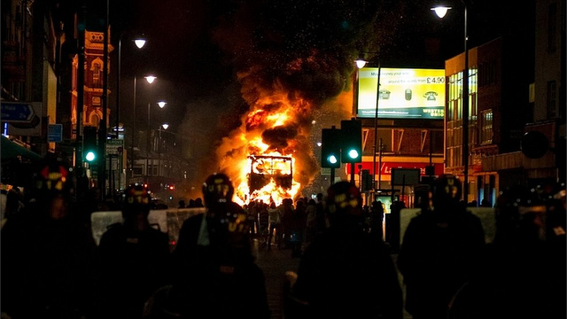 london riots burning bus