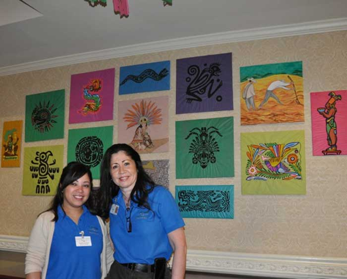 A slice of Mexico! - Using repurposed items, certified Nursing Assistants, Fatima Salcedo and Nancy Ochoa, created over thirty-five original Aztec themed paintings and sculptures for Fiesta de Mayo. A creative team of two, the pair worked on scenery, paintings and decorations everyday for almost four months in order to transform Harmony Village at CareOne at Morris Assisted Living into a Mexican village.