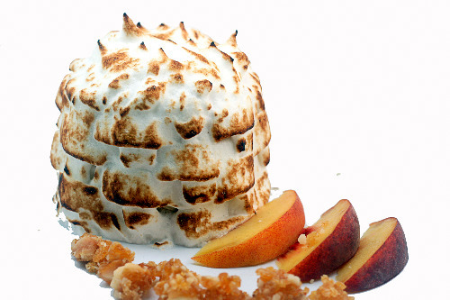 Baked Alaska with Caramel Peach and Macadmia Brittle Ice Cream on Brown Butter Pound Cake