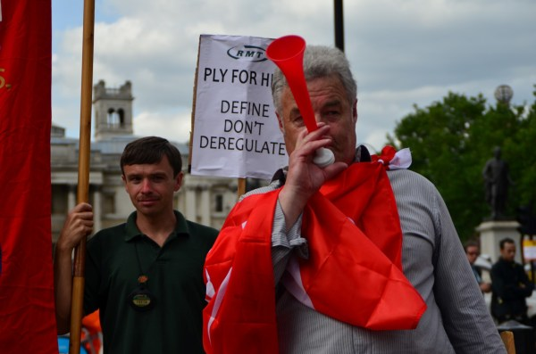 London Cab strike. 11 June 2014.  Cab horns and vuvuzelas or the  lepatata Mambu (its Tswana name), a plastic horn add to the impact! 01