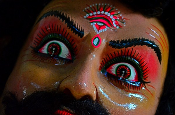 Durga Puja 2015. Close-up of a demon and the fear in his eyes is apparent