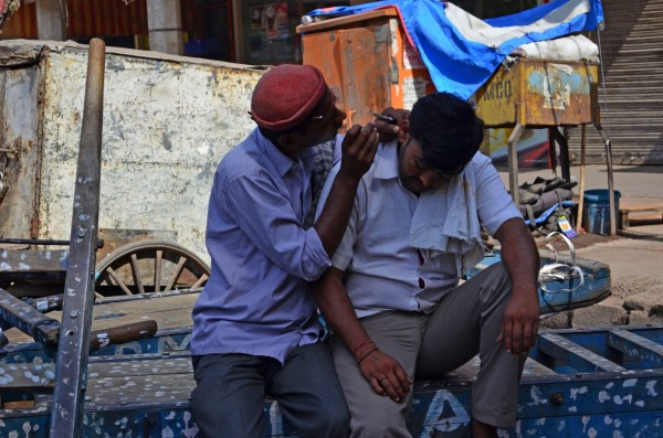 Life in Delhi - finding something to do is both easy and difficult. An ear-cleaning expert on the roadside