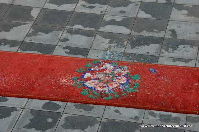 The red carpet laid for the Head Abbot was decorated with mandalas made of colored rice.