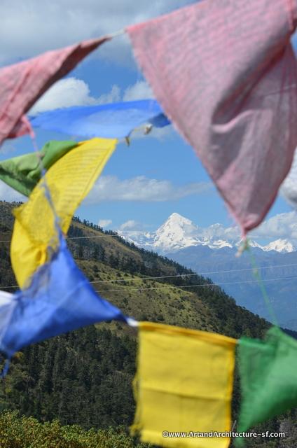 Jhomolhari peeking through the prayer flags
