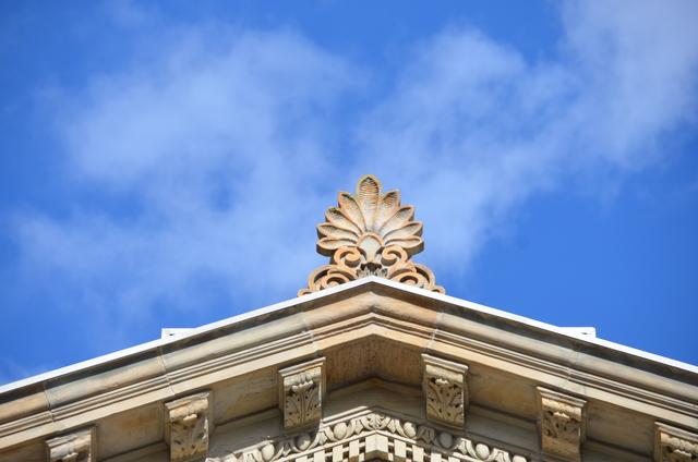 The top of the tympanum on the exterior at the front entrance