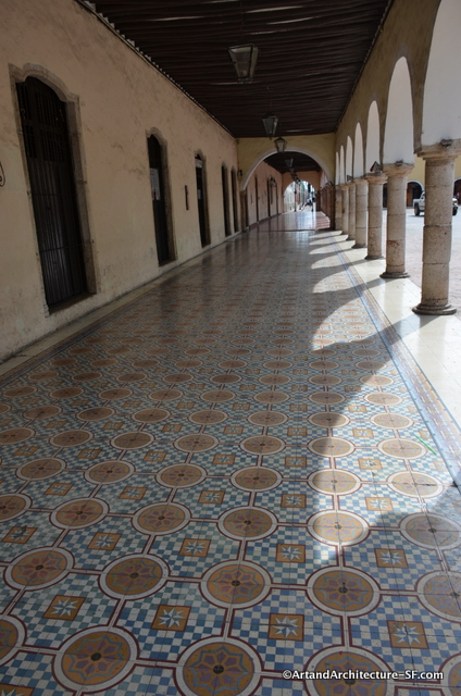The tile floors and arched walkways of colonial architecture