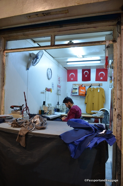 Male tailors, ironing and sewing can be seen throughout the bazaar. It was Sunday so there were not so many working